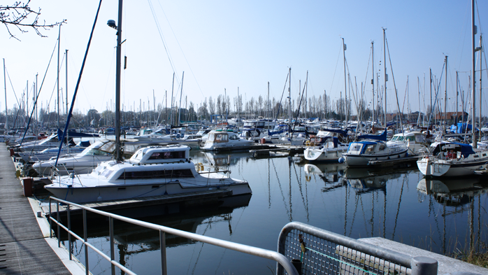 Mixed boats berthed at Chichester Marina in West Sussex