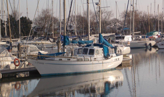 Winter berthing on Chichester Harbour view of boats berthed at Chichester Marina in Winter