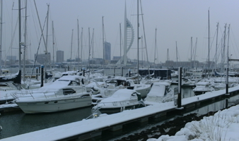 Winter berthing Portsmouth Harbour view of snow on boats berthed at Gosport Marina
