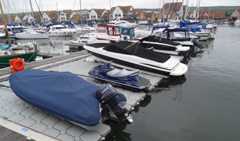 Range of customer small boats using the modern versadock berthing at Port Solent Marina on Portsmouth Harbour