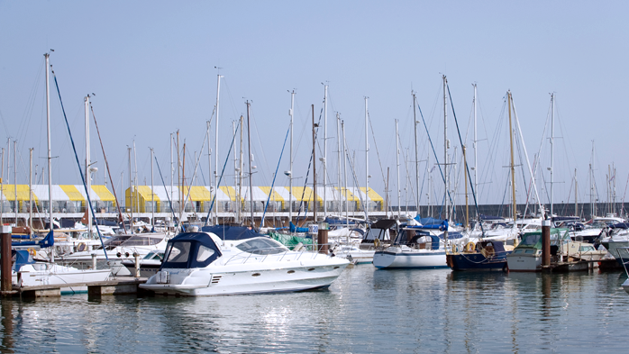 Yachts and motor boats berthing at Brighton marina