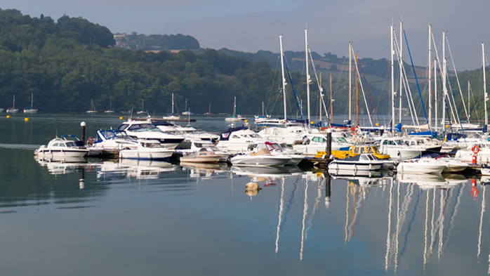 View of boats moored at Noss on the River Dart